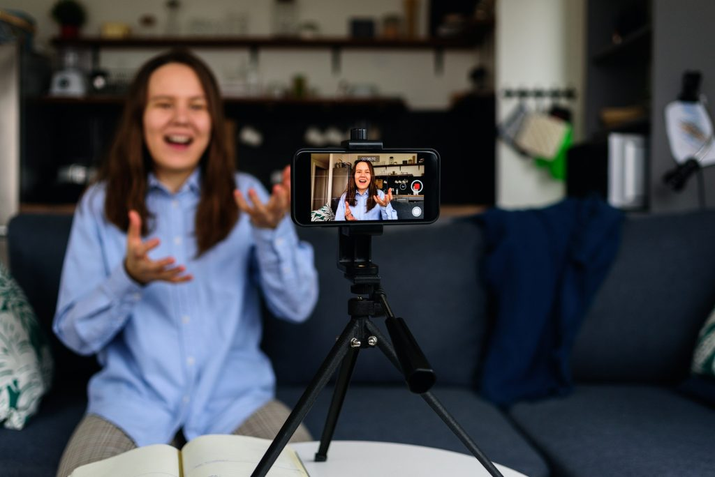 Woman Recording video for blog